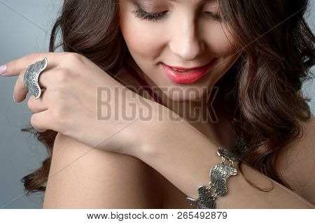 Close-up Studio Portrait Model Demonstrate Stylish Ring And  Bracelet