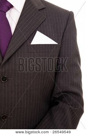 Business man with business card in the pocket, isolates on white
