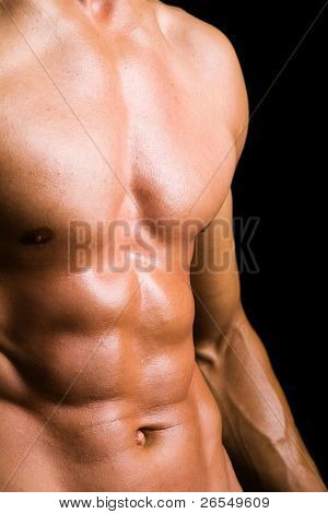 Young man with naked torso on black background poster