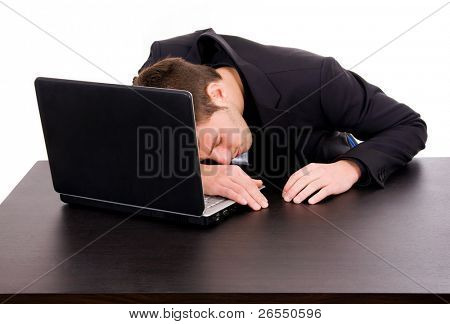 Tired young businessman sleeping on desk, isolated on white