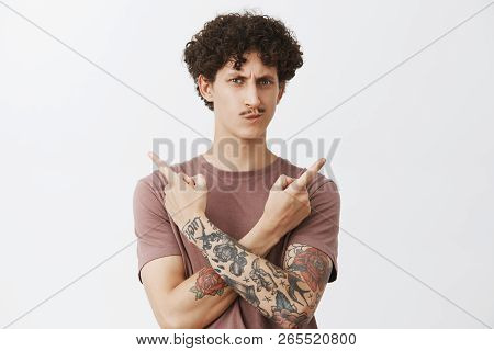 Unsure Hesitating Cute Young Guy With Curly Dark Hair And Fancy Moustache Smirking And Frowning Susp
