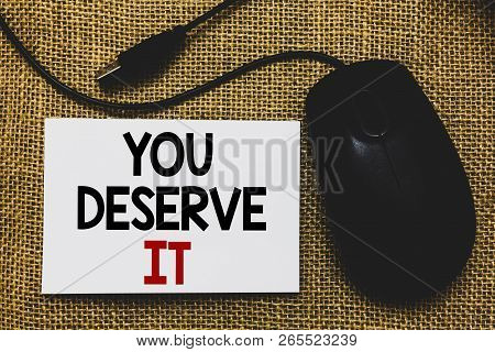 Writing note showing You Deserve It. Business photo showcasing Reward for something well done Deserve Recognition award Traditional mouse alongside white page with written words. poster