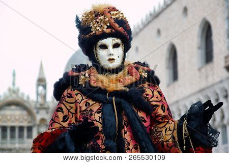 Carnival Black-gold Mask And Costume At The Traditional Festival In Venice, Italy