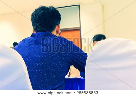 Close Up Businessman On Sit Chair In Education Seminar Training Conference In Interior Meeting Room