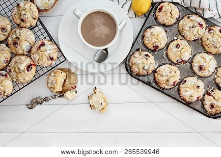 Hot Steaming Coffee And Cranberry Muffins With Butter Over A Rustic White Table  Background. Image S