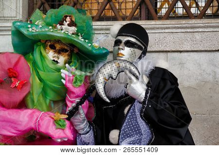 Carnival Pair Multicolor Mask And Costume At The Traditional Festival In Venice, Italy
