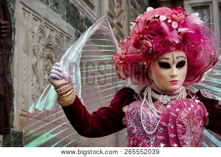 Carnival Pink-white Mask And Costume At The Traditional Festival In Venice, Italy