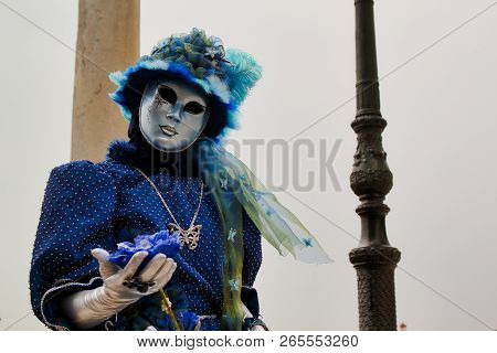Carnival Blue-silver Mask And Costume At The Traditional Festival In Venice, Italy
