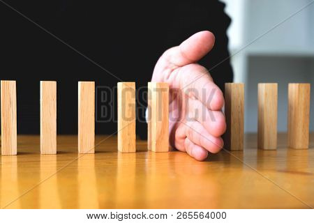 Business Hand Stops Domino Continuous Overturned Meaning That Hindered Business Failure. Stop Over T
