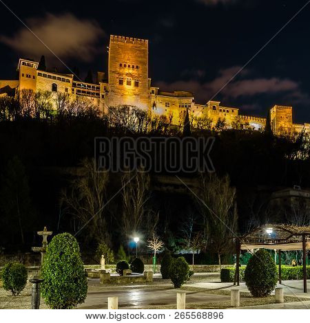 Night Cityscape Of Granada, Spain, With The Alhambra Palace In The Background