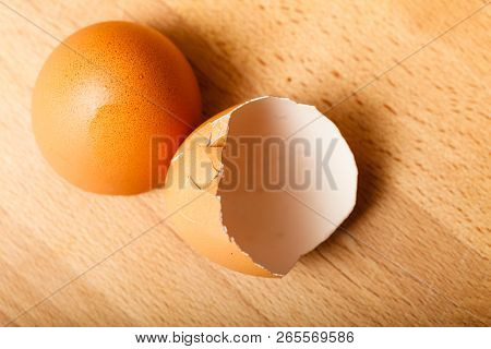 Kitchen food products details concept. Detailed closeup of empty cracked eggshells left after cooking. poster