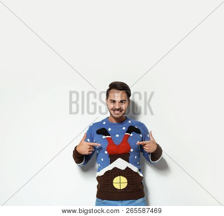 Young Man In Christmas Sweater On White Background