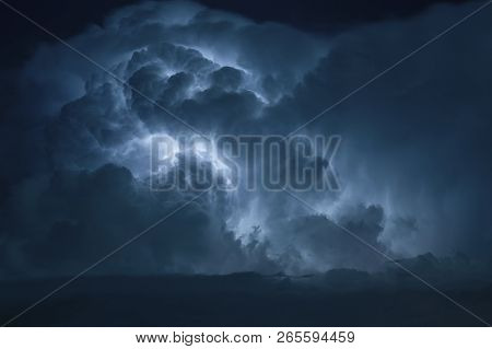 Blue Lightning Strike Surrounded By Storm Clouds