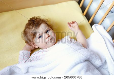 Cute Little Baby Girl Lying In Cot Before Sleeping. Happy Calm Child In Bed. Going Sleep. Peaceful A