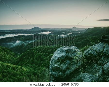 Exposed sandstone rock, forest hilly landscape and green view.  Nature park. poster