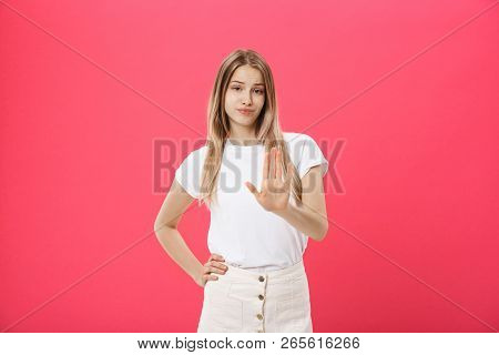 Displeased Female Model With Freckled Skin, Raises Eyebrows And Frowns Face, Makes Refusal Gesture,