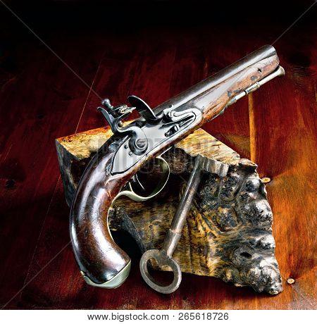 Flintlock Pistol And Jailers Key.
