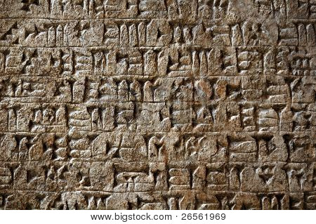 Ancient Sumerian cuneiform writing engraved in a stone poster