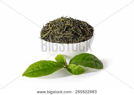 Green sencha tea in white cup with tealeaves in front isolated on white background. poster
