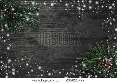 Christmas Card. Black Wood Background, With Pine Branches, Pine Cones, Top View. Xmas Greeting Card