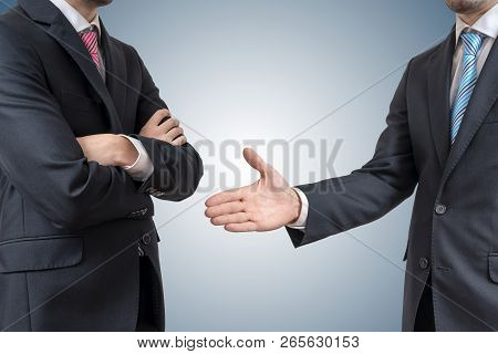 Handshake Refuse. Man Is Refusing Shake Hand With Businessman Who Is Offering His Hand.