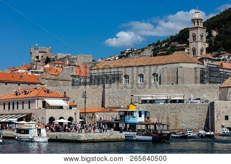 Dubrovnik, Croatia, July 29, 2018: The Dubrovnik Old Town Harbor Is A Part Of The Town 15th Century