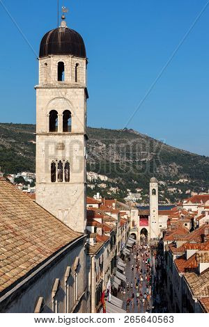 Dubrovnik, Croatia, July 29, 2018: Bell Tower Of The Franciscan Church And Monastery In Dubrovnik, O