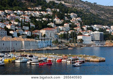 Dubrovnik, Croatia, July 29, 2018: Local Fishing And Cruise Boats In The The Dubrovnik Old Town Harb