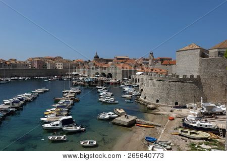 Dubrovnik, Croatia, July 31, 2018: The Dubrovnik Old Town Harbor Is A Part Of The Town 15th Century