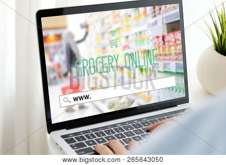 Hand Tying Laptop Computer With Www. On Search Bar Over Blur Grocery Store Background On Screen, Gro