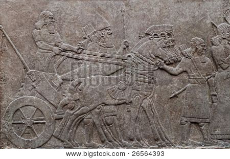 Relief of ancient assyrian warriors in a horse drawn chariot poster