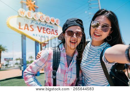 Two Best Friend Taking Selfie With The Welcome To Fabulous Las Vegas Sign In America. Friendship Con