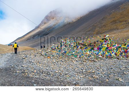 Backpackers On Trekking Path At Thorang-la Pass, Annapurna Conservation Area, Nepal