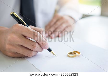 Closeup Of A Man Signing Contract Or Premarital Agreement, Filling Petition Form Agreement Of Divorc