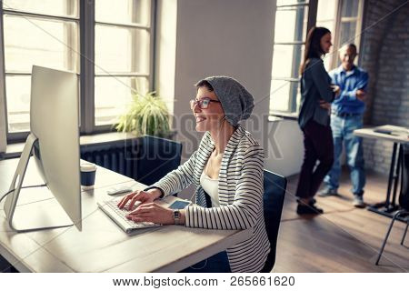 Young woman work on computer in company