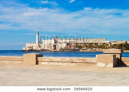 The castle of El Morro in Havana with part of El Malecon wall in the foreground