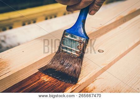 Painter With Paintbrush Painting Wooden Surface For Protection Wood From External Influences - Retro