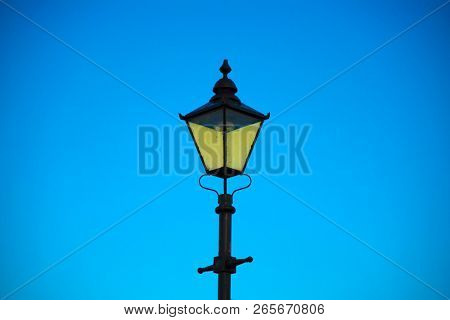 Street light isolated on a blue sky background