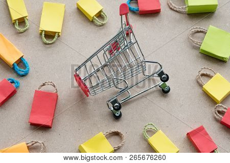 Mini Shopping Cart Or Trolley Surround With Colorful Mini Shopping Bag, Can Use For Background Shopp