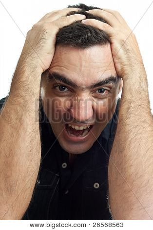 Latin man yelling with his hands on his head and a violent or desperate face isolated on a white background