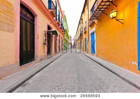 Street in Old Havana sidelined by typical colorful buildings