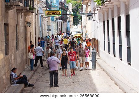 HAVANA-AUGUST 12:Tourists visiting the famous Bodeguita del Medio August 12,2011 in Havana. This famous restaurant,where mojito was created,is one of the attractions Old Havana has for its visitors