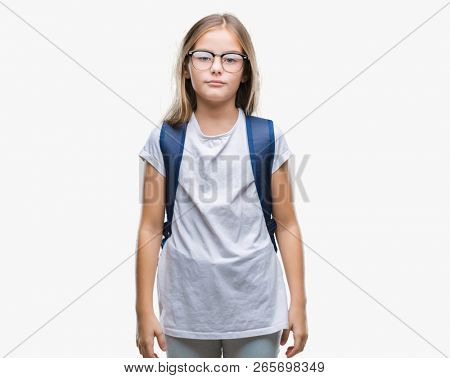 Young beautiful smart student girl wearing backpack over isolated background with serious expression on face. Simple and natural looking at the camera.