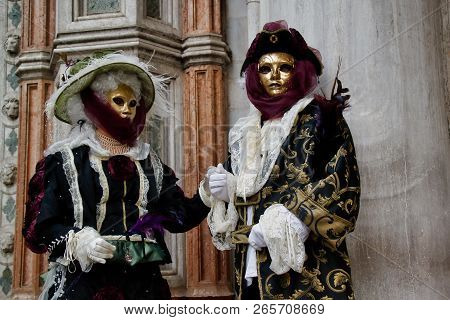 Carnival Multicolor Mask And Costume At The Traditional Festival In Venice, Italy
