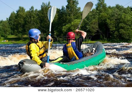 Kayaker sporting a kayak cuts through water