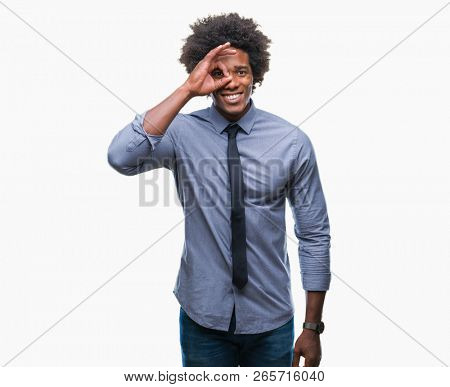 Afro american business man over isolated background doing ok gesture with hand smiling, eye looking through fingers with happy face.