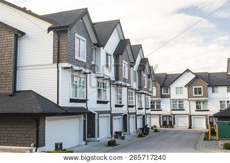 Brand New Townhouses With Concrete Pavement In Front. Front Side Of Townhouses On Sunny Day In Canad