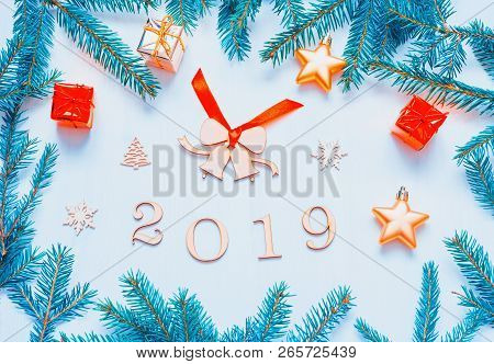New Year 2019 background with 2019 figures, Christmas toys, fir branches. Flat lay, top view of New Year 2019 still life