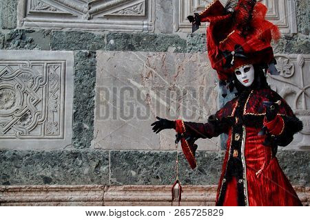Carnival Red-black Mask And Costume At The Traditional Festival In Venice, Italy