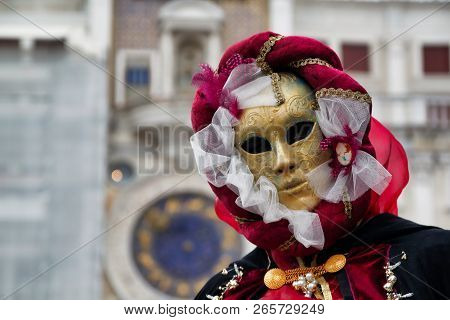 Carnival Red-gold Mask And Costume At The Traditional Festival In Venice, Italy